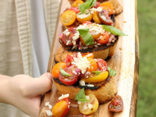 tomato bruschetta on wooden cutting board