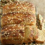 three loaves of oatmeal bread, one sliced