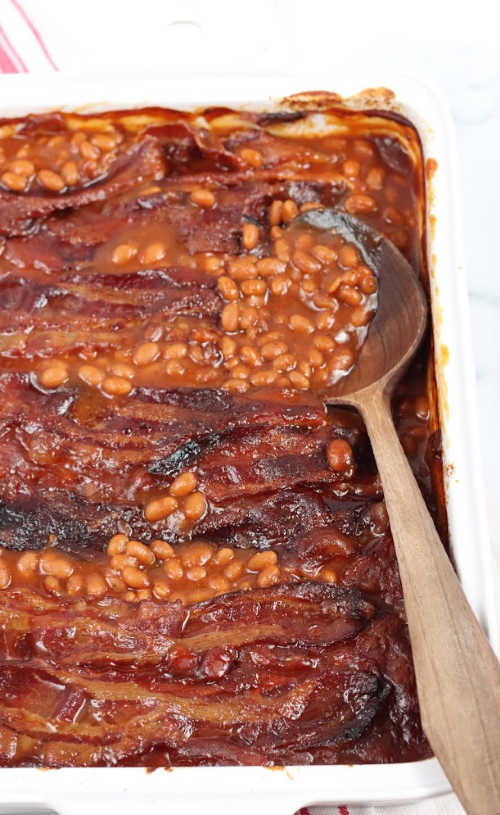 baked beans in a white rectangle baking dish