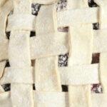 unbaked pie with lattice crust on half sheet pan