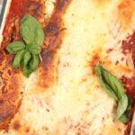lasagna in a rectangle cast iron baking pan