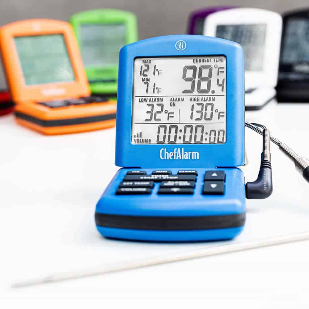 ThermoWorks Chef alarm thermometer with probe in blue and different colors.