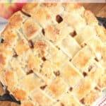 lattice crust on an apple pie in cast iron pie pan.