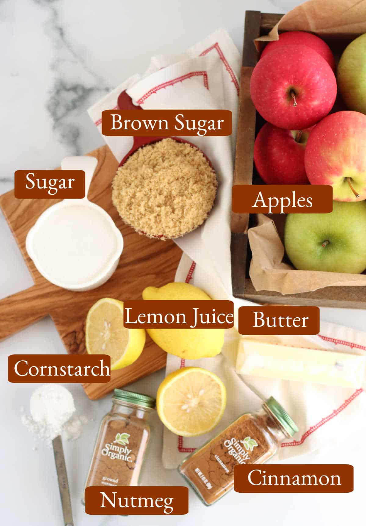 Ingredients on white marble for apple hand pies.
