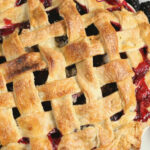 Blackberry pie with lattice crust and berry juices bubbling up around edges.