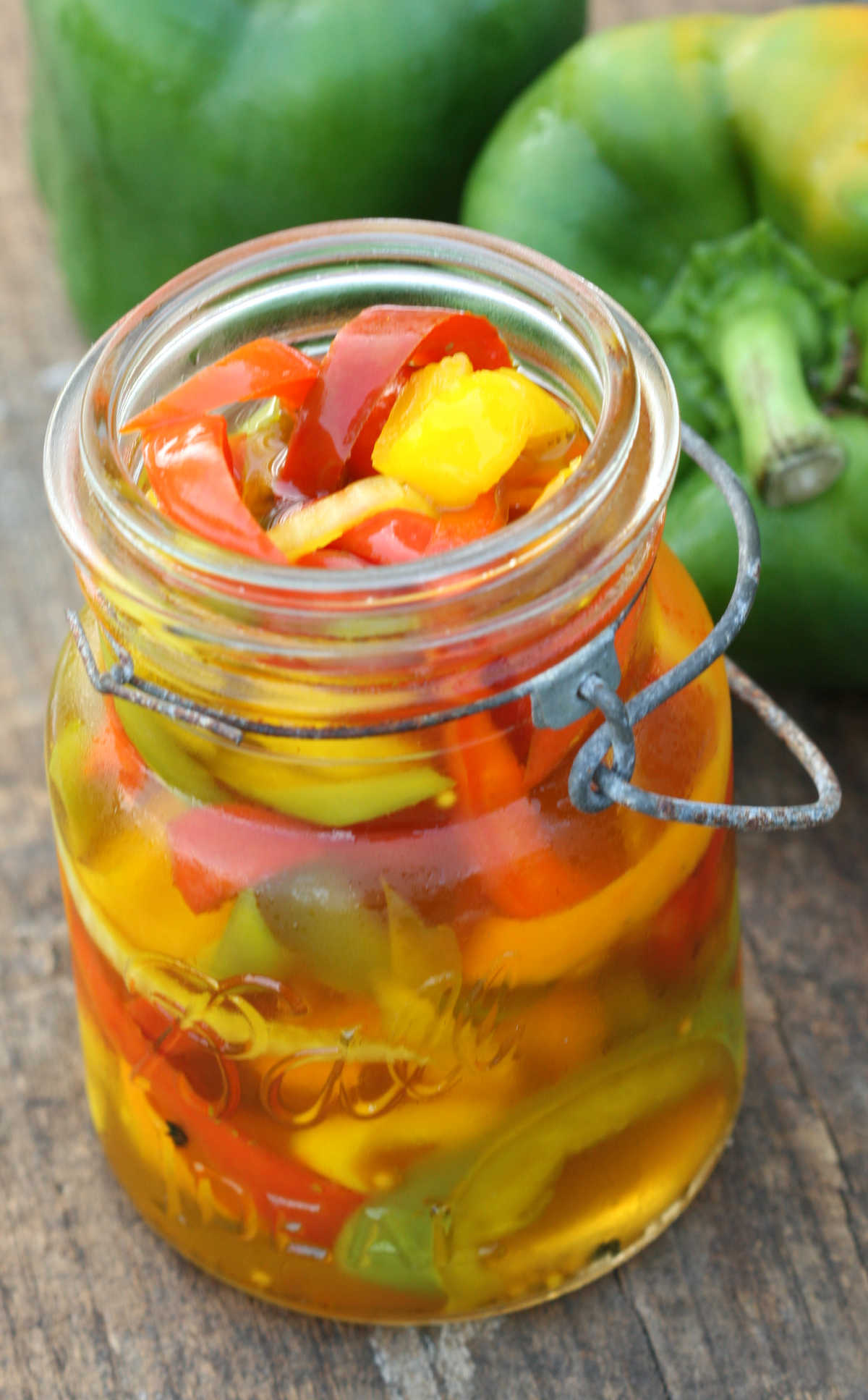 Sweet pickled Peppers in vintage Mason Jars on reclaimed wood boards.