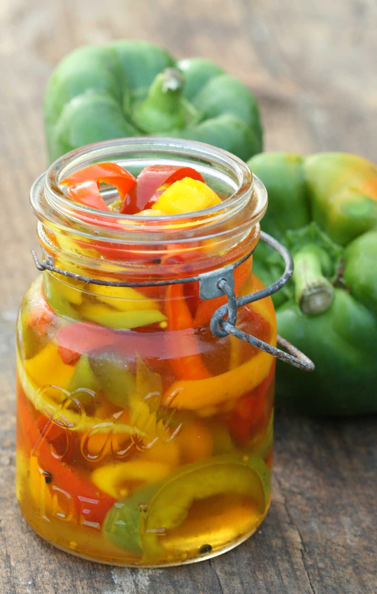 Vintage Mason jar of pickling peppers on reclaimed wood board.
