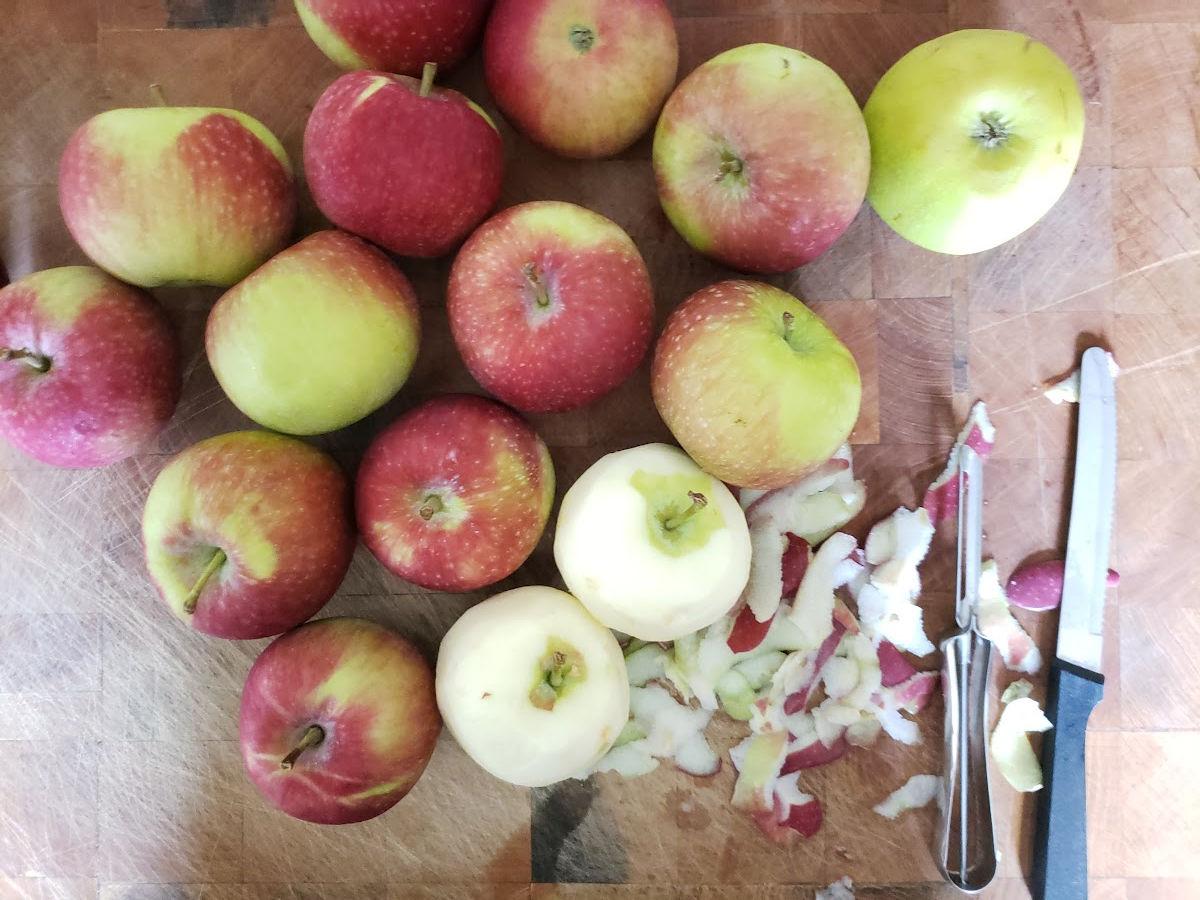 Peeling apples on butcher block.