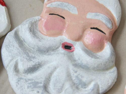 Santa salt dough ornament drying on brown Kraft paper.